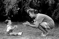 african_american_mother and toddler on grass