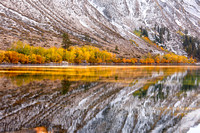 New Snow and Aspens in trees in fall foliage reflecting in quiet Convict Lake_Sierra Nevada Mountains_California_MK3A1747_Rob badger