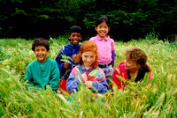 children in grass field elementary school diversity casual_master