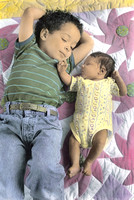 Brother and newborn sister on sunflower quilt handcolored