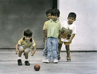 School boys/friends playing ball in an elementary school yard in Oakland, California. San Francisco Bay Area. Photographed by Nita Winter, healthcare art
