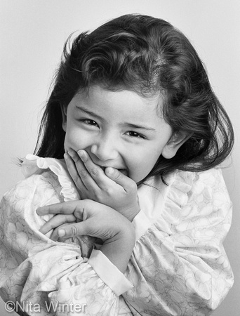 Girl laughing into her hands. Nita Winter People Photography