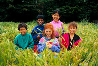 children in grass field elementary school diversity_color_master